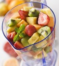 Mixed fruit in blender close up shoot
