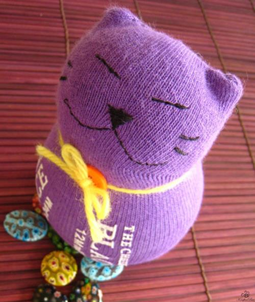 Foto: http://www.craftpassion.com/2010/09/sewing-sock-kitty-tutorial-guest-tutor.html/2